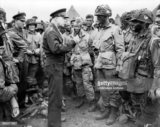 General Dwight D Eisenhower talking with American paratroopers on the evening of June 5 as they prepared for the Invasion of Normandy Greenham Common...