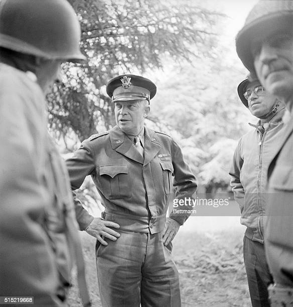 General Dwight D Eisenhower talks with troops at the headquarters of the United States 1st Division in Normandy The General also participated in...