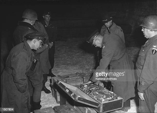 General Dwight Eisenhower commander of Allied Forces inspects gold bars taken from jews by the Nazi's and stashed in the Heilbron Salt Mines May 3...