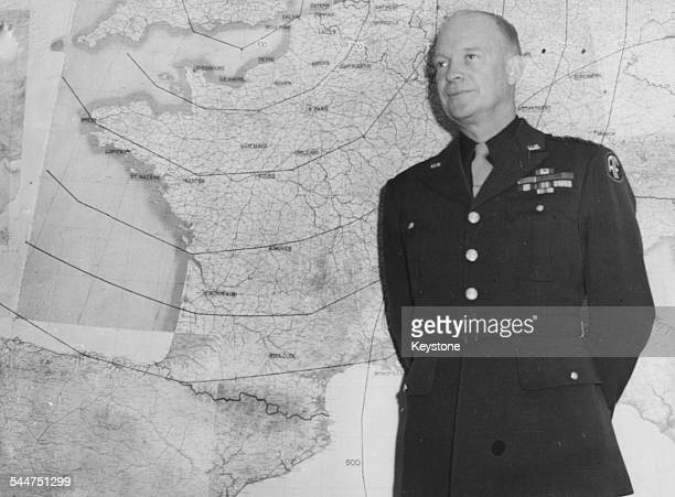 General Dwight Eisenhower standing in front of a large wall map in his office London January 17th 1944