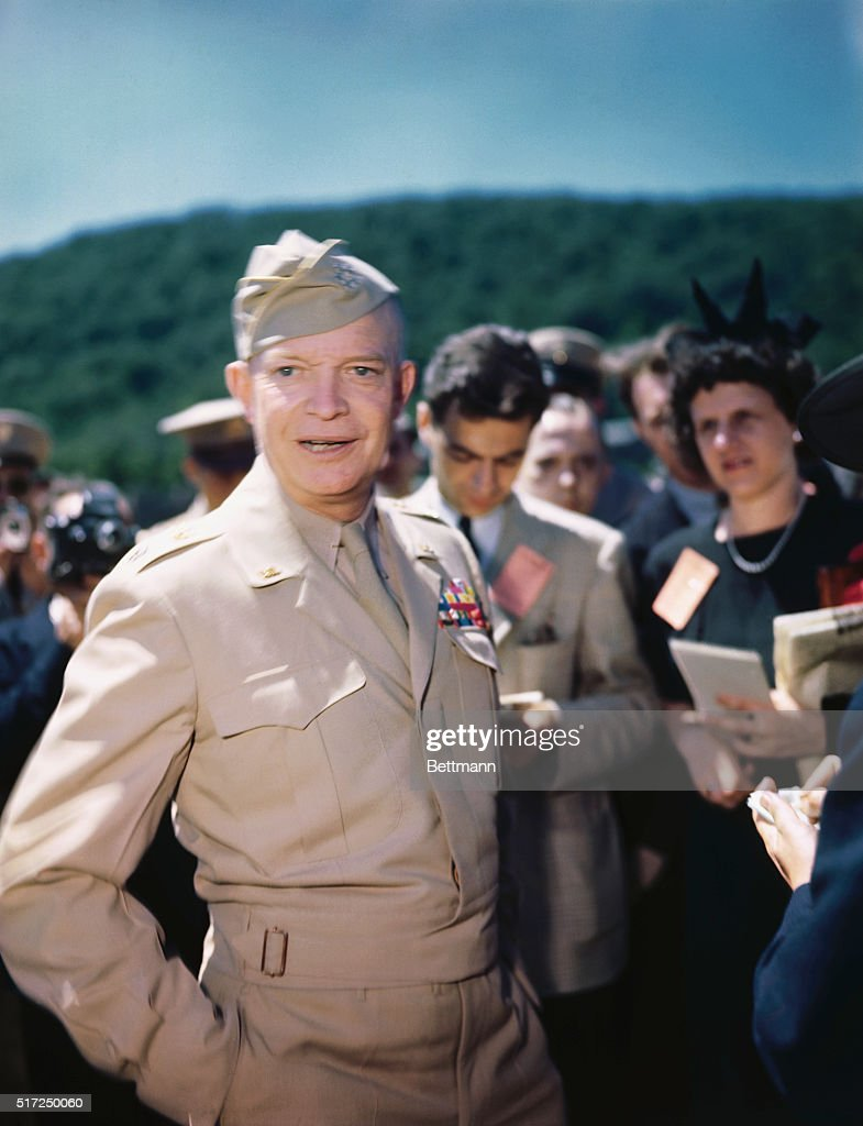 General Dwight Eisenhower takes some time to talk to reporters during a review of West Point's cadet corps.