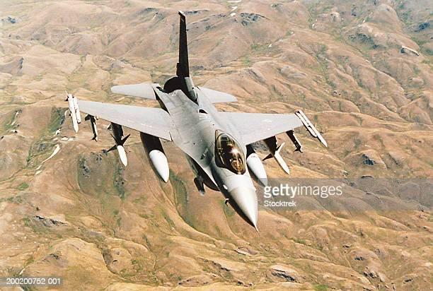 General Dynamics F-16 Falcon in flight over desert