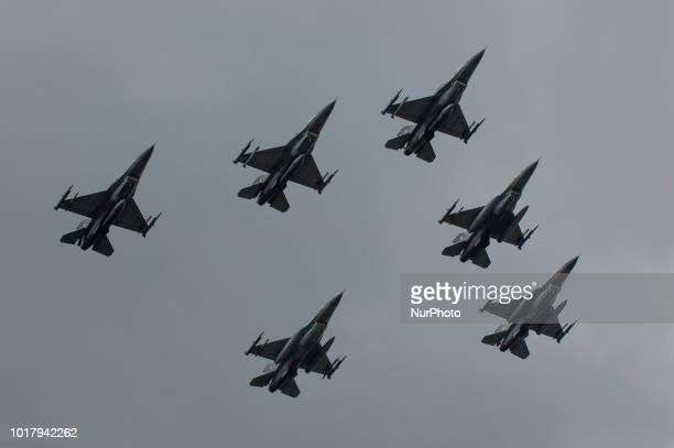 General Dynamics F16 fighter jets are seen flying over crowds during the Armed Forces Day parade in Warsaw Poland on August 15 2018