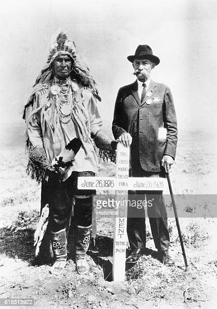 General E S Godfrey and White Man Runs Him last of the Crow stand by the monument marker at the site of the Battle of the Little Big Horn in which...