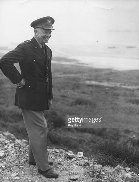 General Eisenhower smiling as he stand on Omaha Beach on the anniversary of the DDay landings Normandy June 20th 1951