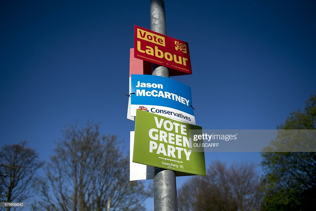 General election campaign posters for the Labour party, the Conservative Party and the Green Party are attached to a lamp post in the 'Colne Valley' constituency in Slaithwaite, northern England, on April 21, 2015. Britain goes to the polls on MAy 7 to elect a new parliament.