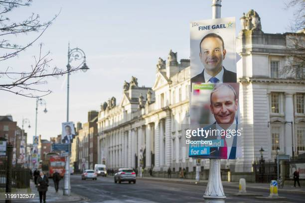 General election posters depicting Leo Varadkar Ireland's prime minister and leader of Fine Gael and Micheal Martin leader of Fianna Fail hang from a...