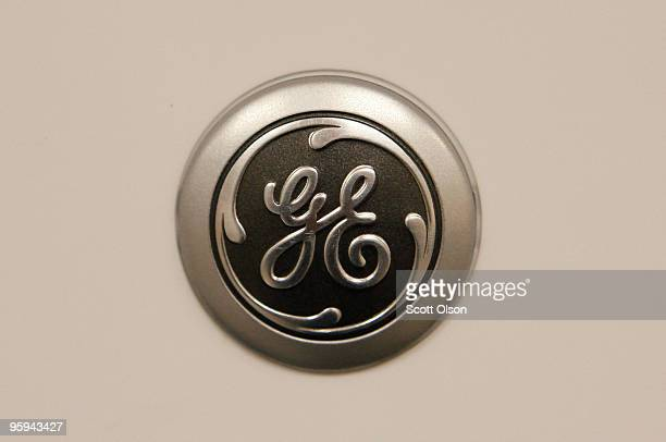 General Electric Co. Logo is displayed on the door of one of the company's microwave ovens being offered for sale at a Sears store January 22, 2010...