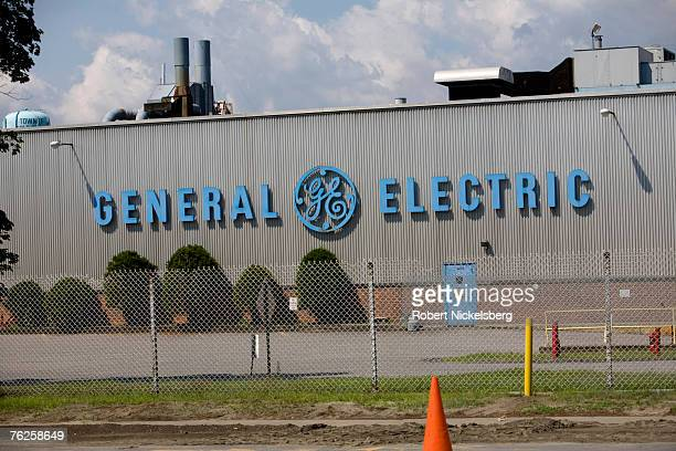 General Electric logo hangs on the side of a GE factory that produces electrical capacitors that once used, buried and discharged cancer linked...