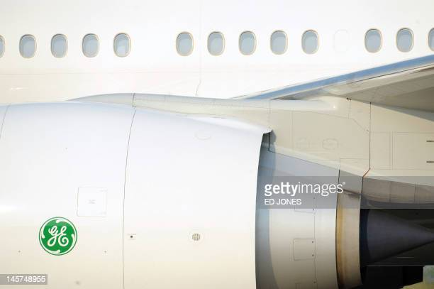 A General Electric logo is displayed on the engine of the Boeing 777 aircraft of Turkmenistan's President as it arrives at Beijing's international...