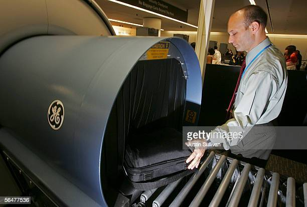General Electric representative demonstrates an explosives detecting scanner with a laptop computer bag at the San Francisco International Airport...