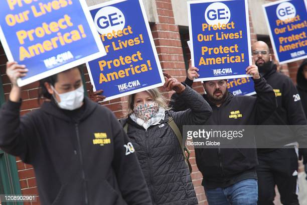 General Electric workers hold a protest on Necco Street in Boston, MA out of concerns for their safety on March 30, 2020. The machinists, hand-tool...