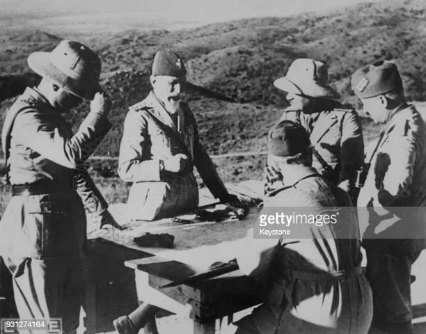 General Emilio De Bono of the Italian Army CommanderinChief of the Italian Forces in Eritrea gives orders to his officers on an observation post on...