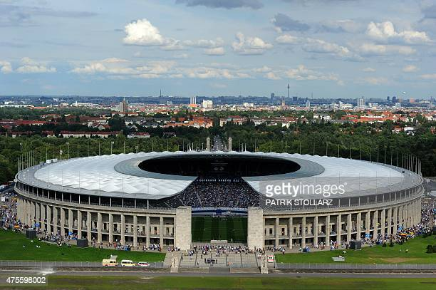 General exterior view of Berlin's Olympic stadium taken as supporters arrive to attend the friendly football match Hertha Berlin vs Real Madrid on...
