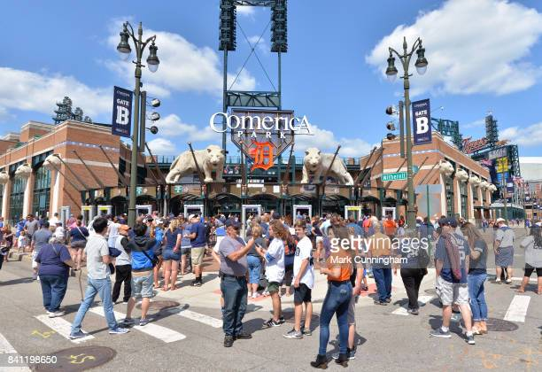 A general exterior view of Comerica Park as fans lineup and wait to enter prior to the game between the Los Angeles Dodgers and the Detroit Tigers at...