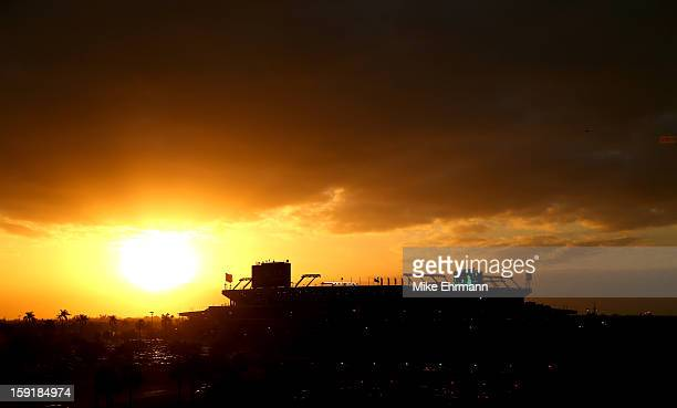 A general exterior view of the sun setting behind Sun Life Stadium prior to the Florida State Seminoles playing against the Northern Illinois Huskies...