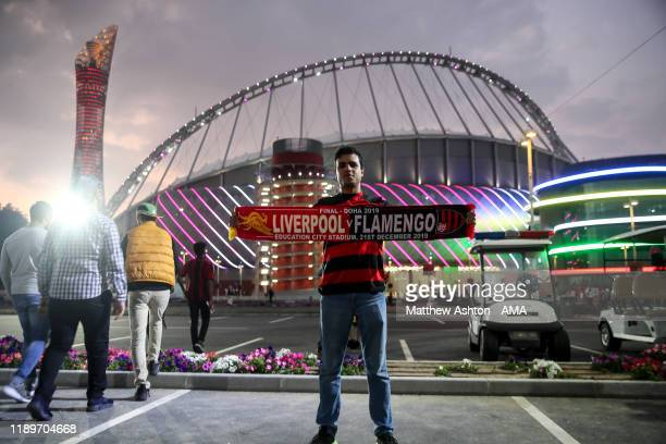 A general external view of Khalifa International Stadium host venue of FIFA World Cup Qatar 2022 at dusk as a fan of Flamengo holds a half and half...