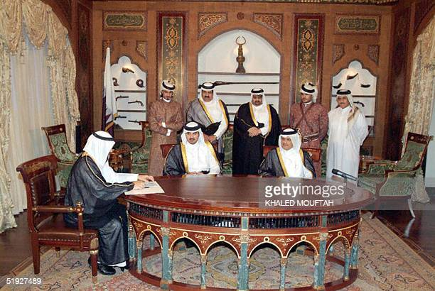 A general family shot shows Qatar's Crown Prince Sheikh Tamim bin Hamad alThani during the signing of his marriage contract in the presence of his...