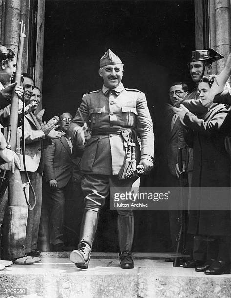 General Francisco Franco chief of the Southern Rebel Army in Spain walking out of a building through a group of cheering people