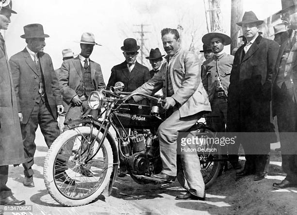 """General Francisco """"Pancho"""" Villa poses with a motorcycle which was used in the Battle of Torreon."""