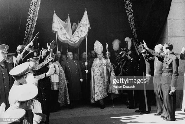General Franciso Franco the dictator of Spain leaves the requiem of the late King Alphonso XIII under a canopy and accompanied by the bishop |...