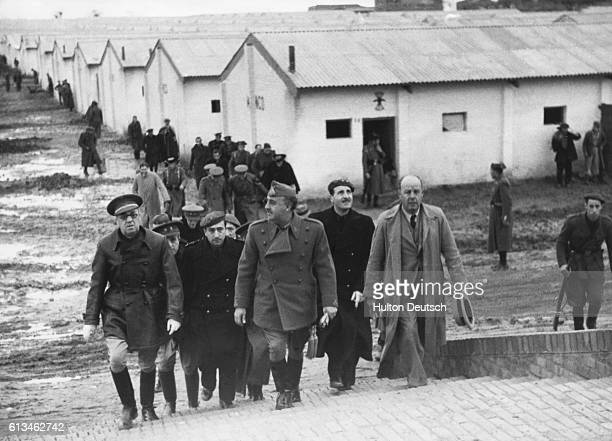 General Franco and his staff during a visit to Usera a suburb of Madrid which is being rebuilt after suffering extensive damage in the Civil War |...
