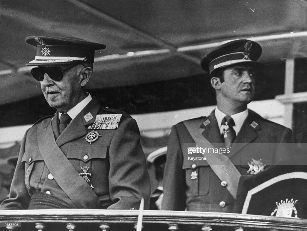 General Franco (1892 - 1975) and Prince Don Juan Carlos watching the military parade on the 35th anniversary of the end of the Civil War.