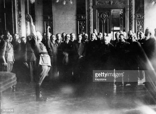 General Franco taking an oath during a ceremony where he is proclaimed Supreme Head of the insurgent 'Nationalist Government'