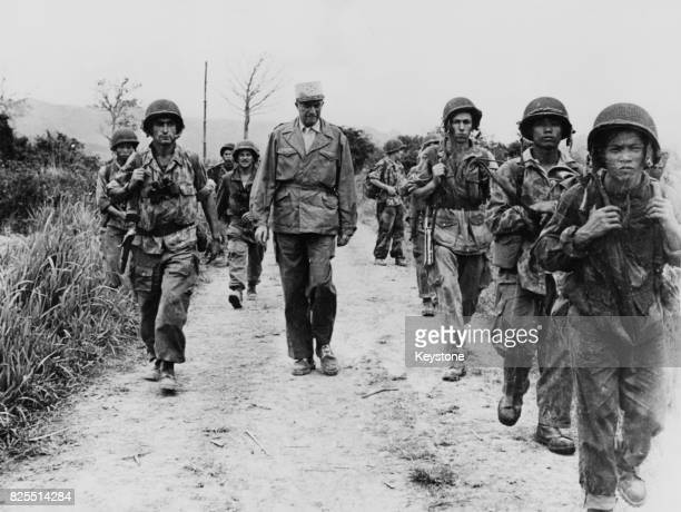 General Francois De Linares CommanderinChief of the French forces in Indochina inspects soldiers joining the front in the Hoa Binh area of Vietnam...