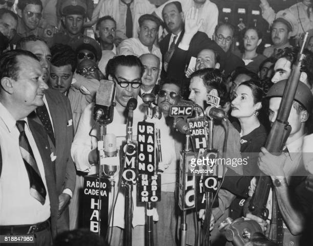 General Fulgencio Batista surrounded by supporters following the military coup which restored him to power as President of Cuba 12th March 1952