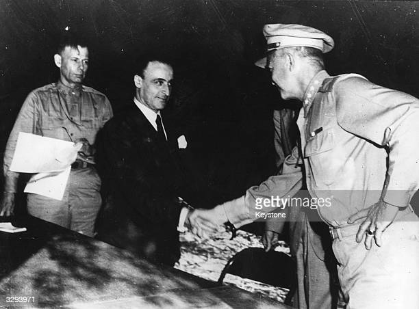 General G Castellano, representing Italy, receives a handshake from General Dwight D Eisenhower, supreme commander of Allied Forces, after the...