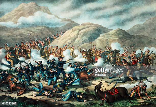 General George Armstrong Custer makes a brave stand with guns in both hands as his soldiers go down in defeat in a romanticized 1889 lithograph of...