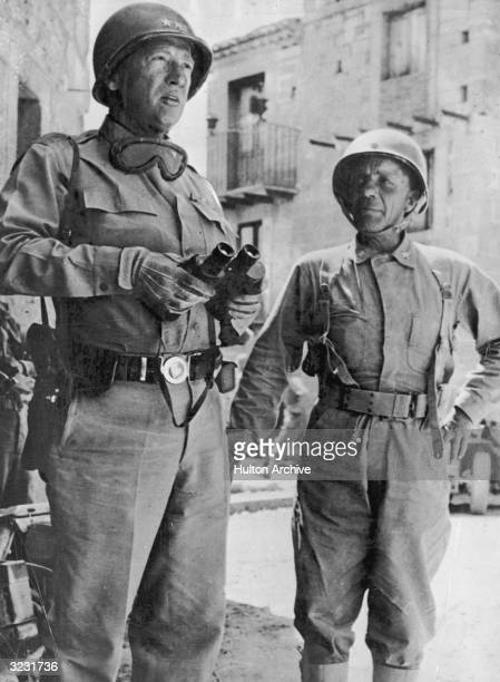 General George Patton confers with Assistant Commanding General Theodore Roosevelt Jr during the US Invasion of Sicily, July 1943.
