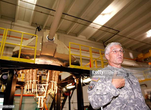 General George W. Casey, Jr., chief of staff for the U.S. Army, speaks about a new Future Combat Systems cannon, seen at rear, at the General...