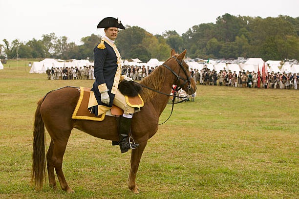 General George Washington reviews Patriot and Colonial Troops at camp before marching to Surrender Field at the 225th Anniversary of the Victory at...