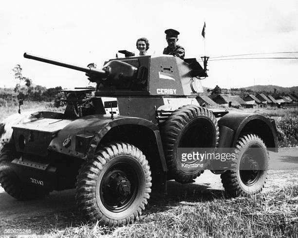 General Gerald Templer, High Commissioner of Malaya, with his wife inspecting the inside of a tank during a tour of the Kedah State, June 17th 1952.
