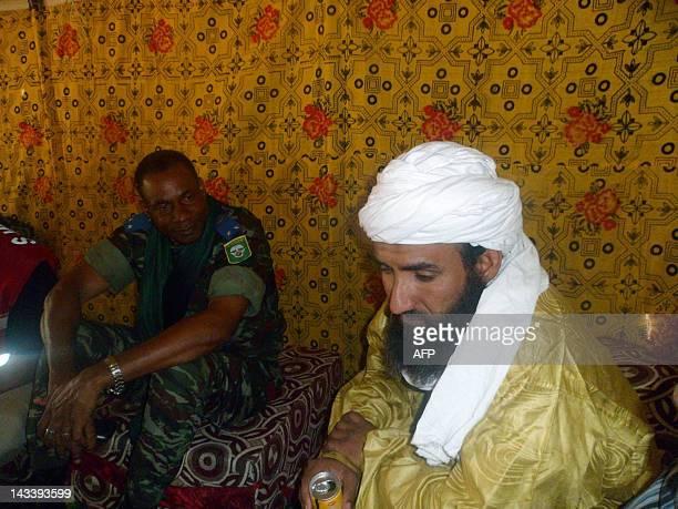 General Gilbert Diendere, Burkina Faso presidency chief of staff talks with an unidentified man on April 24, 2012 near Timbuktu, rebel-held northern...