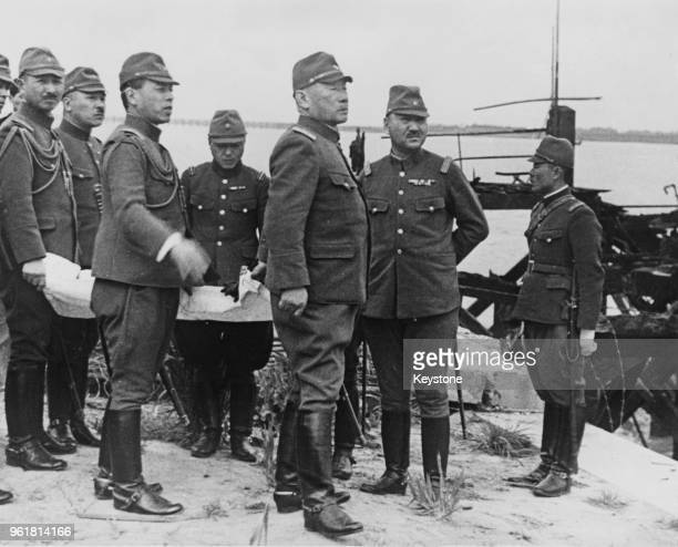 General Hajime Sugiyama of the Imperial Japanese Army the Japanese Minister of War inspects the Japanese landing site at Woosung Shanghai during a...