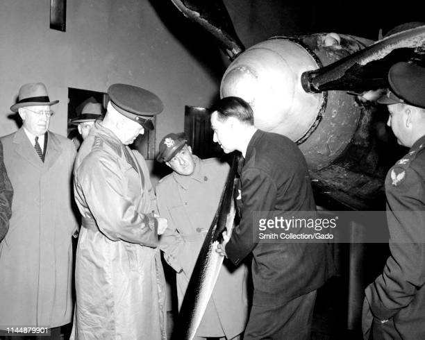 General Henry Harley 'Hap' Arnold , in long coat, inspects ice formation on propeller blades at the Aircraft Engine Research Laboratory in Cleveland,...