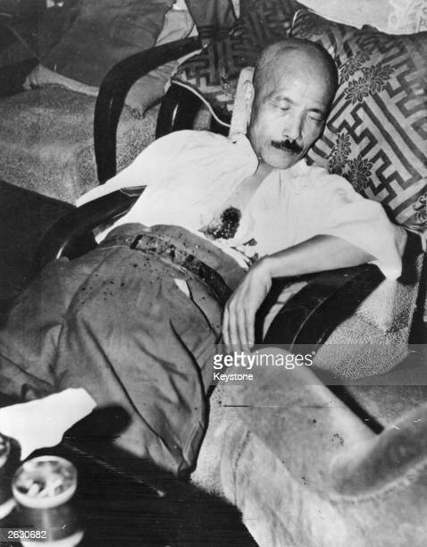 General Hideki Tojo former premier of Japan sprawling in a chair with a selfinflicted gunshot wound to the chest He had attempted suicide to escape...