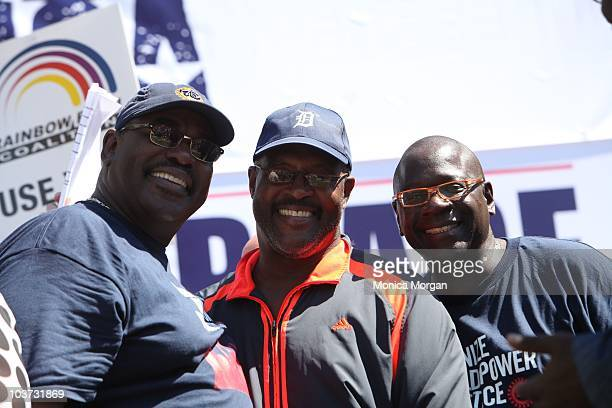 General Holiefield Rev Marvin Winans and John Mason participate in a 'Rebuild AmericaJobs Justice and Peace' march at UAWFord National Programs...