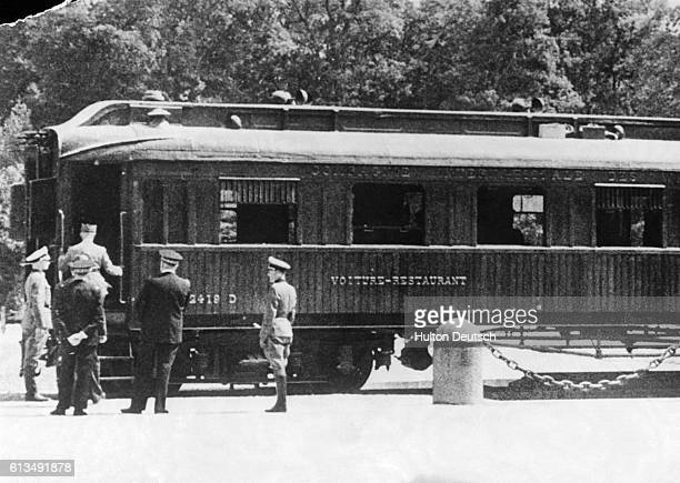 General Huntziger, one of the delegates of the Petain government, enters the famous Compiegne railway carriage where Hitler will stage his theatrical...