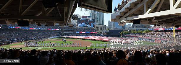 A general interior view of PETCO Park with a large American Flag stretched across the outfield during the singing of the National Anthem prior to the...
