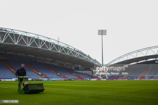 A general internal view of The John Smiths Stadium home stadium of Huddersfield Town as a groundsman mows the pitch prior to the Premier League match...