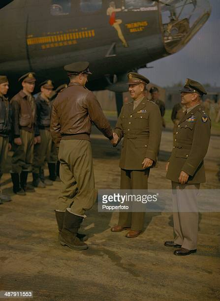 1943 General Jacob L Devers US Chief of the European Army shaking hands with Robert K Morgan Captain of the B17 Flying Fortress 'Memphis Belle'...