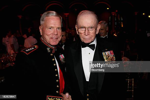 General James Amos commandant of the US Marine Corps left and General PX Kelley the 28th commandant of the US Marine Corps attend the US Navy...