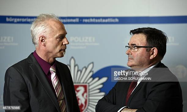 General JeanPierre Michel head of the judicial police of the French gendarmerie speaks with German ChiefInspector Roland Wolff at the Police station...