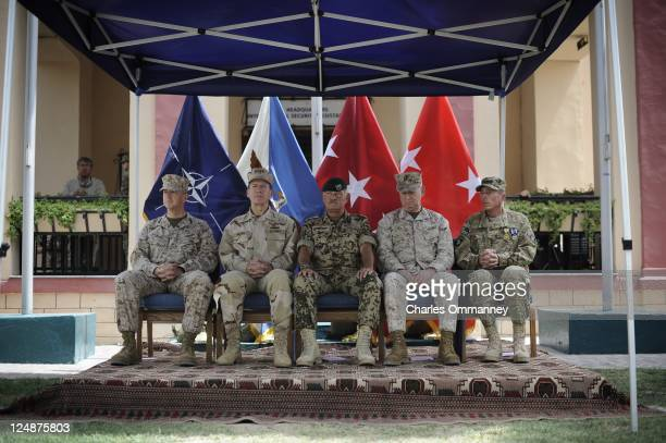 General John Allen, Admiral Mike Mullen, General Wolf Langheld, General James Mattis and General David Petraeus attend a change of guard ceremony as...