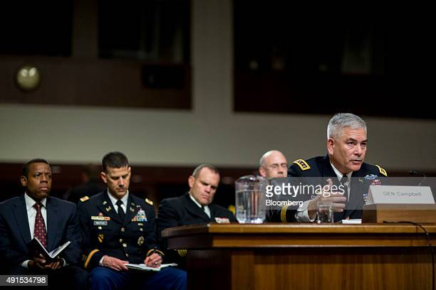 General John Campbell commander of the US forces in Afghanistan right speaks during a Senate Armed Forces Committee hearing in Washington DC on...