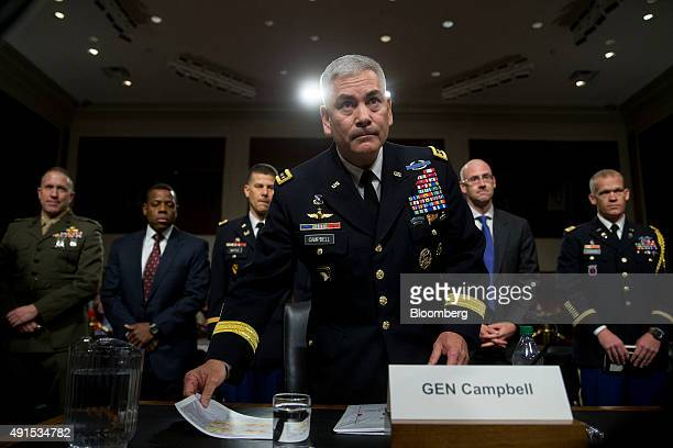 General John Campbell commander of the US forces in Afghanistan arrives to a Senate Armed Forces Committee hearing in Washington DC on Tuesday Oct 6...